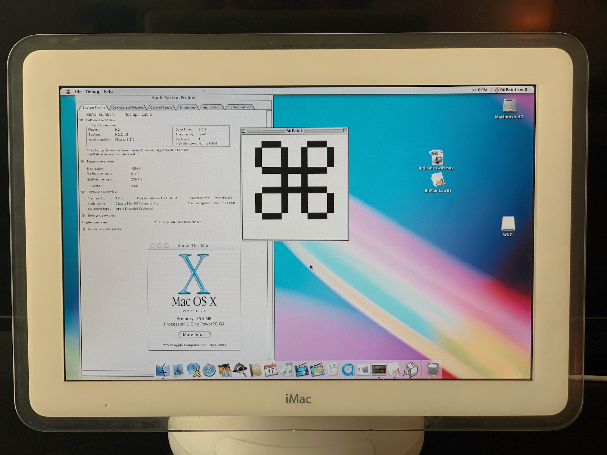 "You can see BitPaint running in the middle, and the Classic version of Apple System Profiler...but also the Mac OS X ""About This Computer"" box showing 10.2.8."